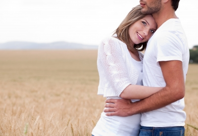 Happy couple in field, farmers and ranchers